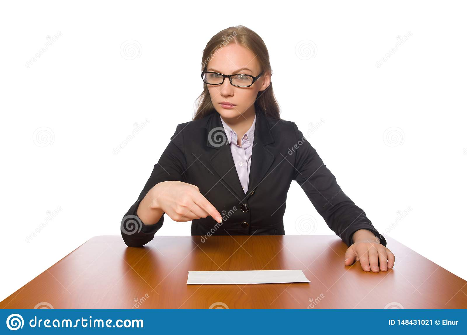 The female employee sitting at long table isolated on white