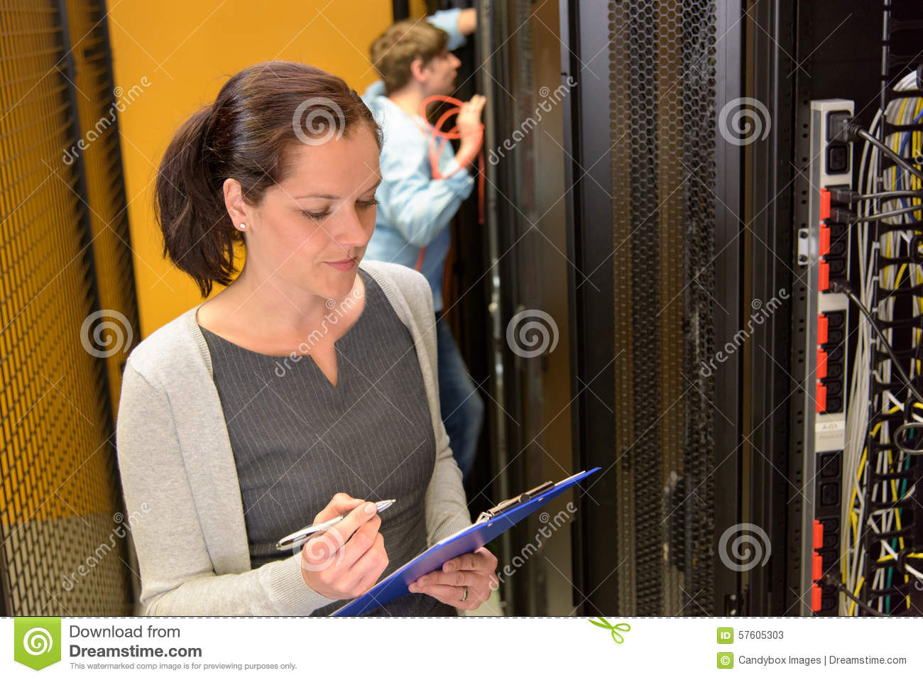 Female engineer in datacenter