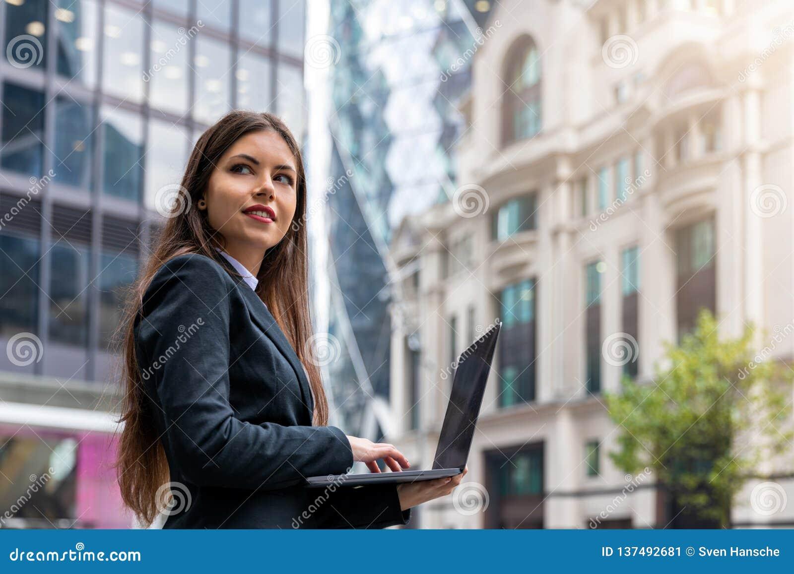 Female entrepreneur in front of office buildings