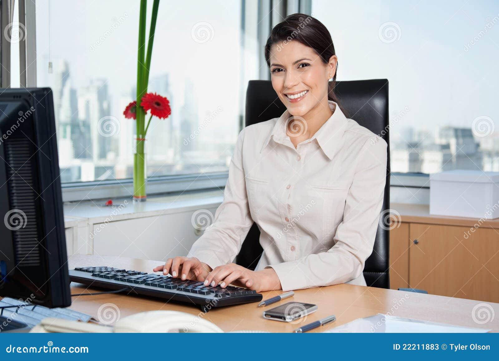 Female Entrepreneur Working On Computer Stock Photos - Image: 22211883