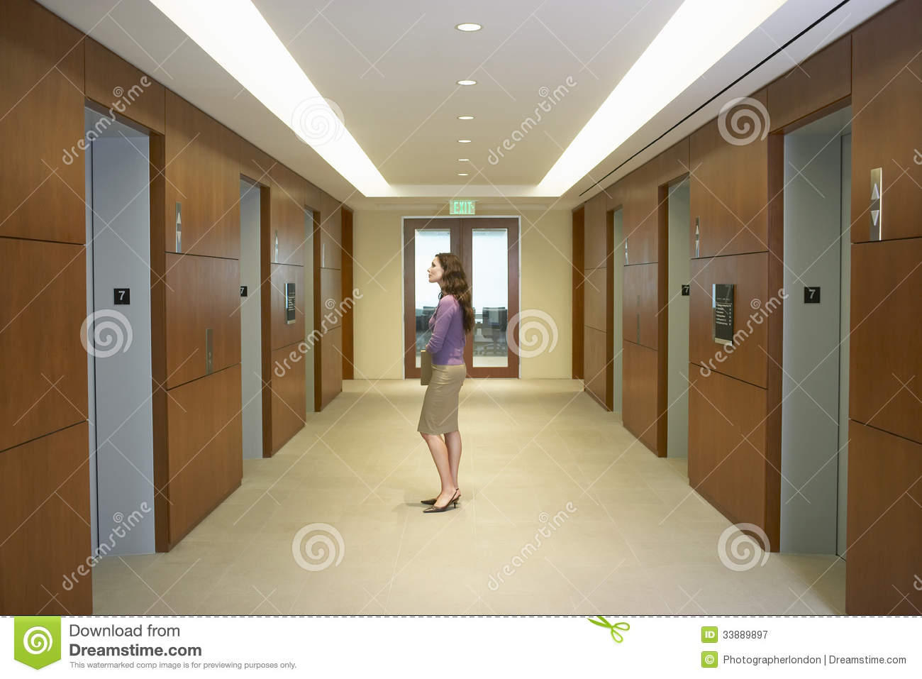 Female Executive Standing In Elevator Lobby Stock Image ...