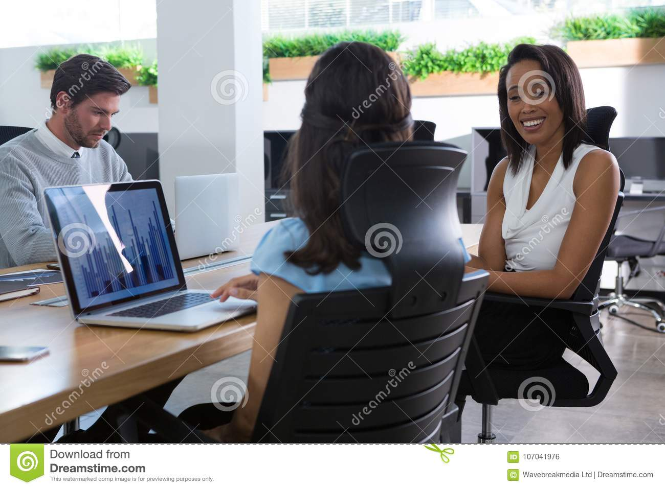Female executive talking to each other at desk