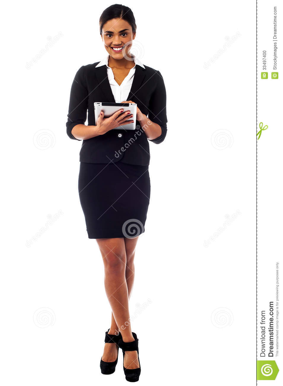 Female executive using touch pad, full length shot