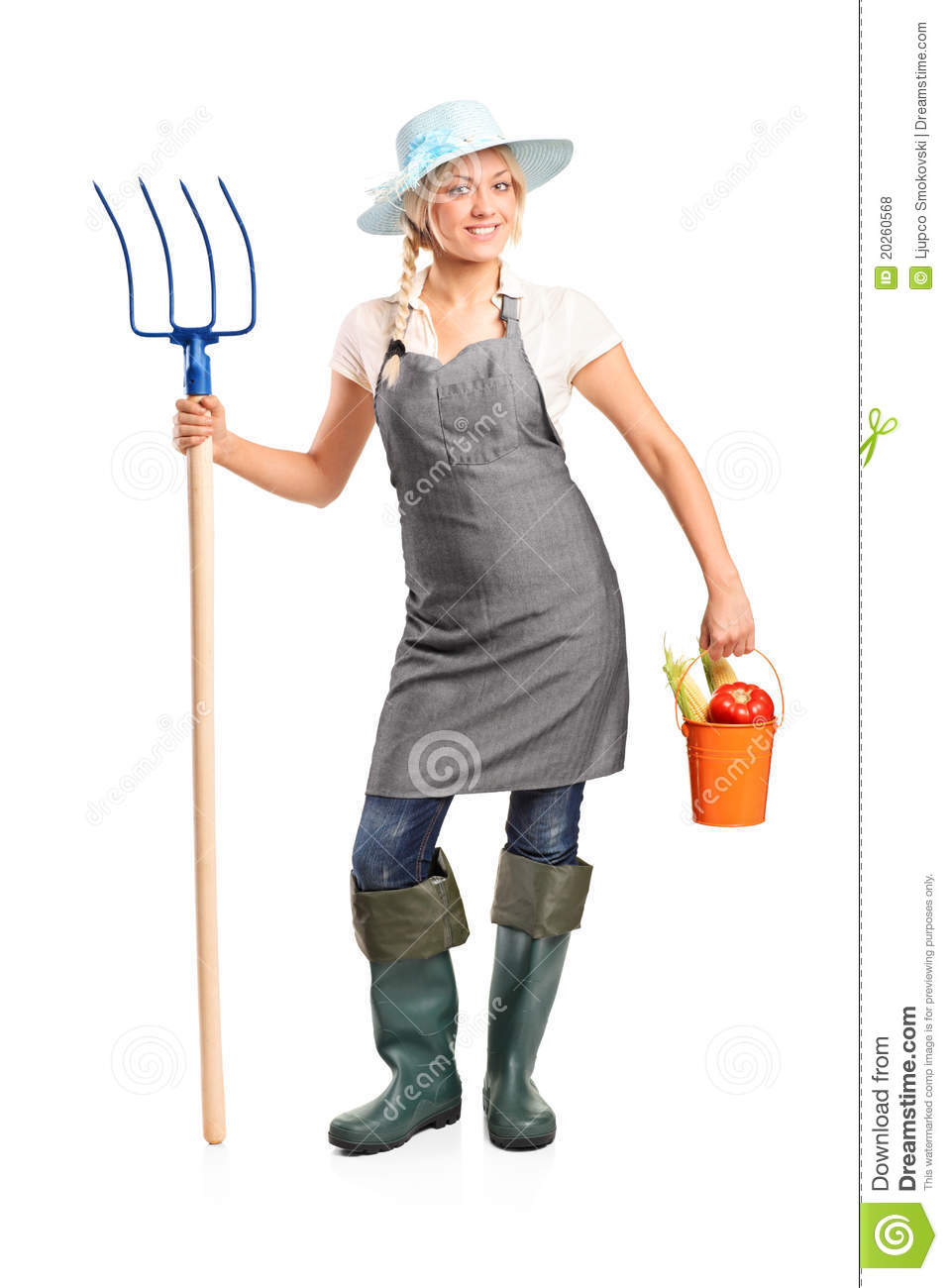 Female farmer holding a pitchfork and bucket