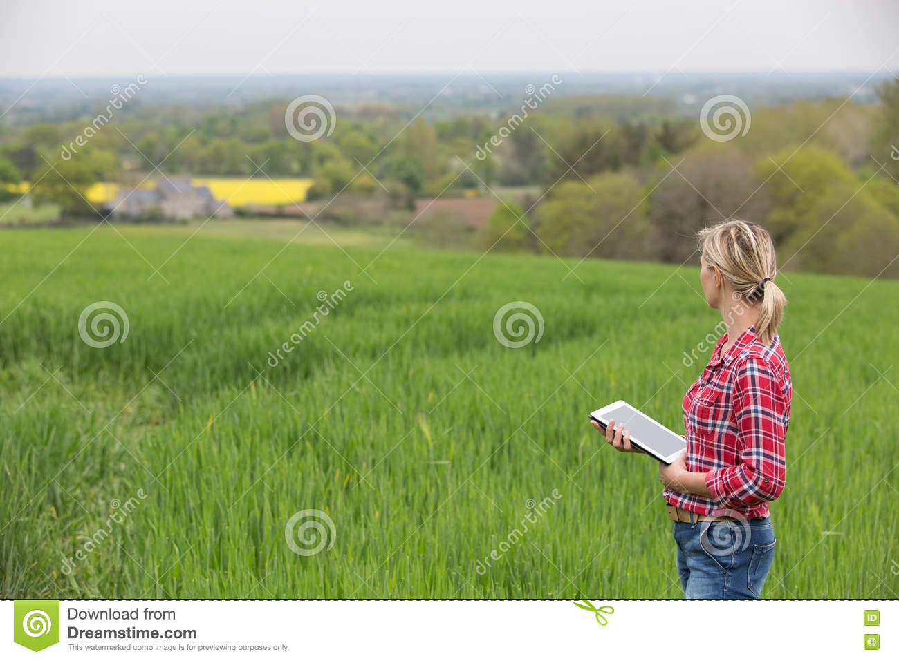 Female farmer working with electronics
