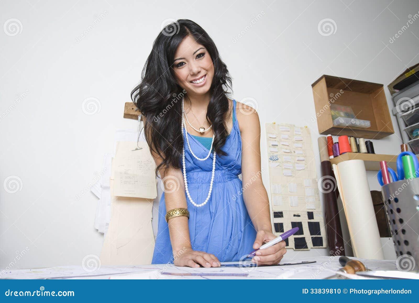 Female Fashion Designer At Desk Stock Photo - Image of ...