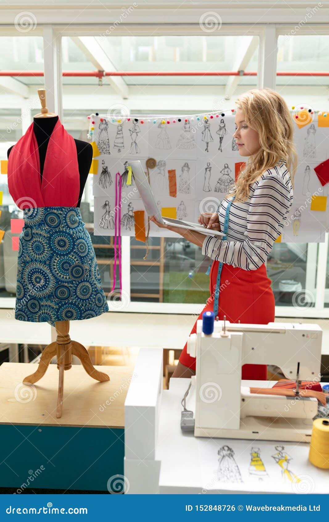 Female Fashion Designer Using Laptop In Design Studio Stock Photo Image Of Caucasian Global 152848726