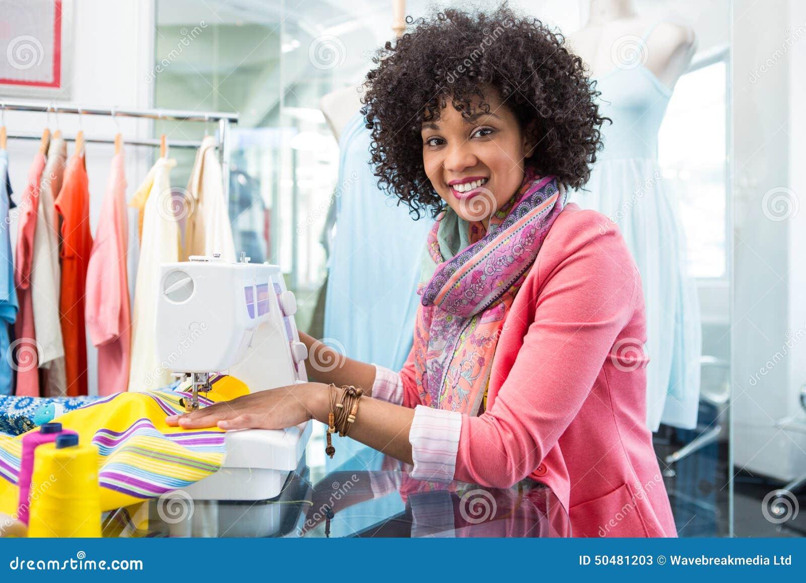 Female Fashion Designer Using Sewing Machine Stock Photo ...