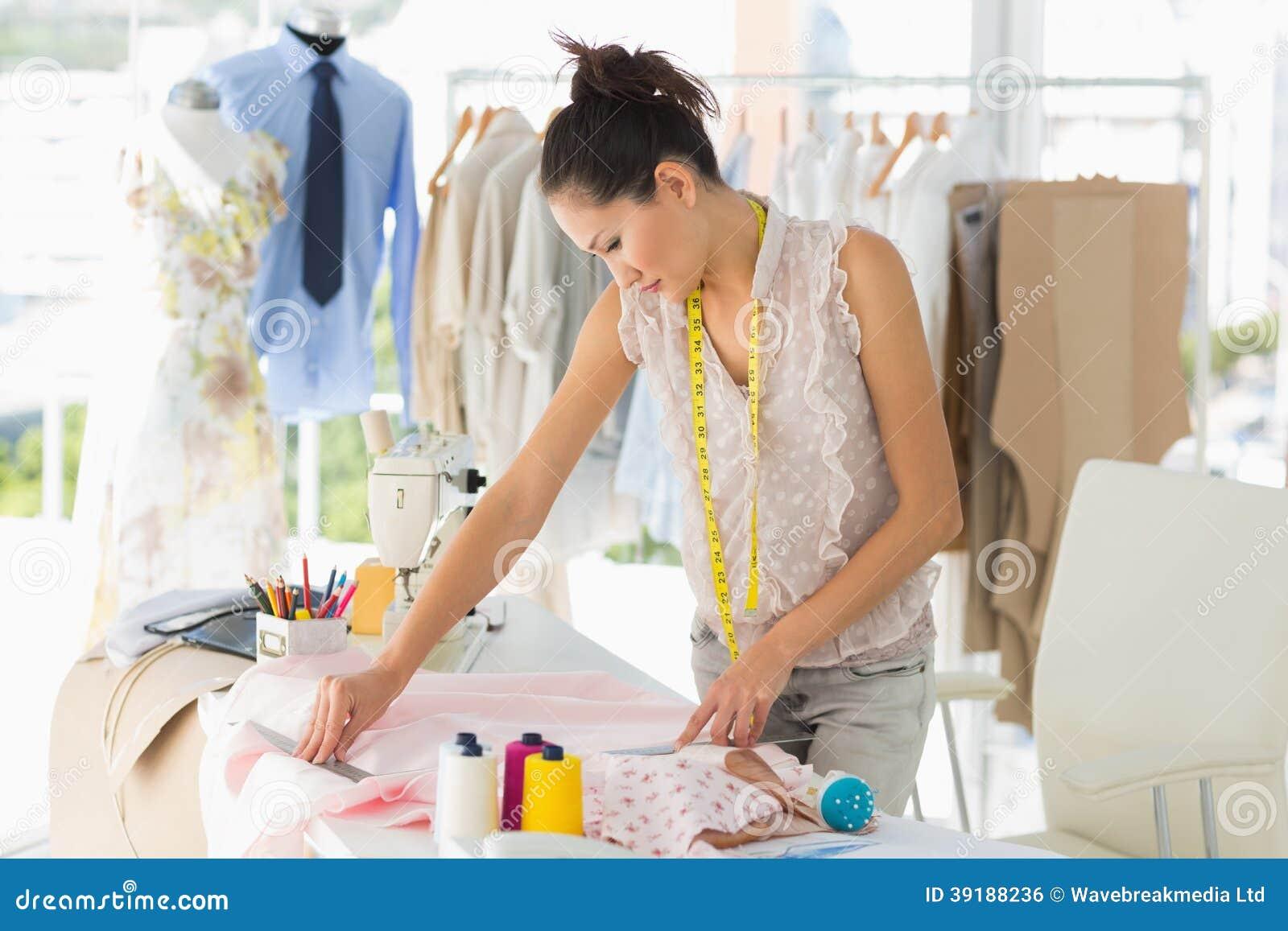 Young Female Fashion Designer Working On Fabrics Royalty ...