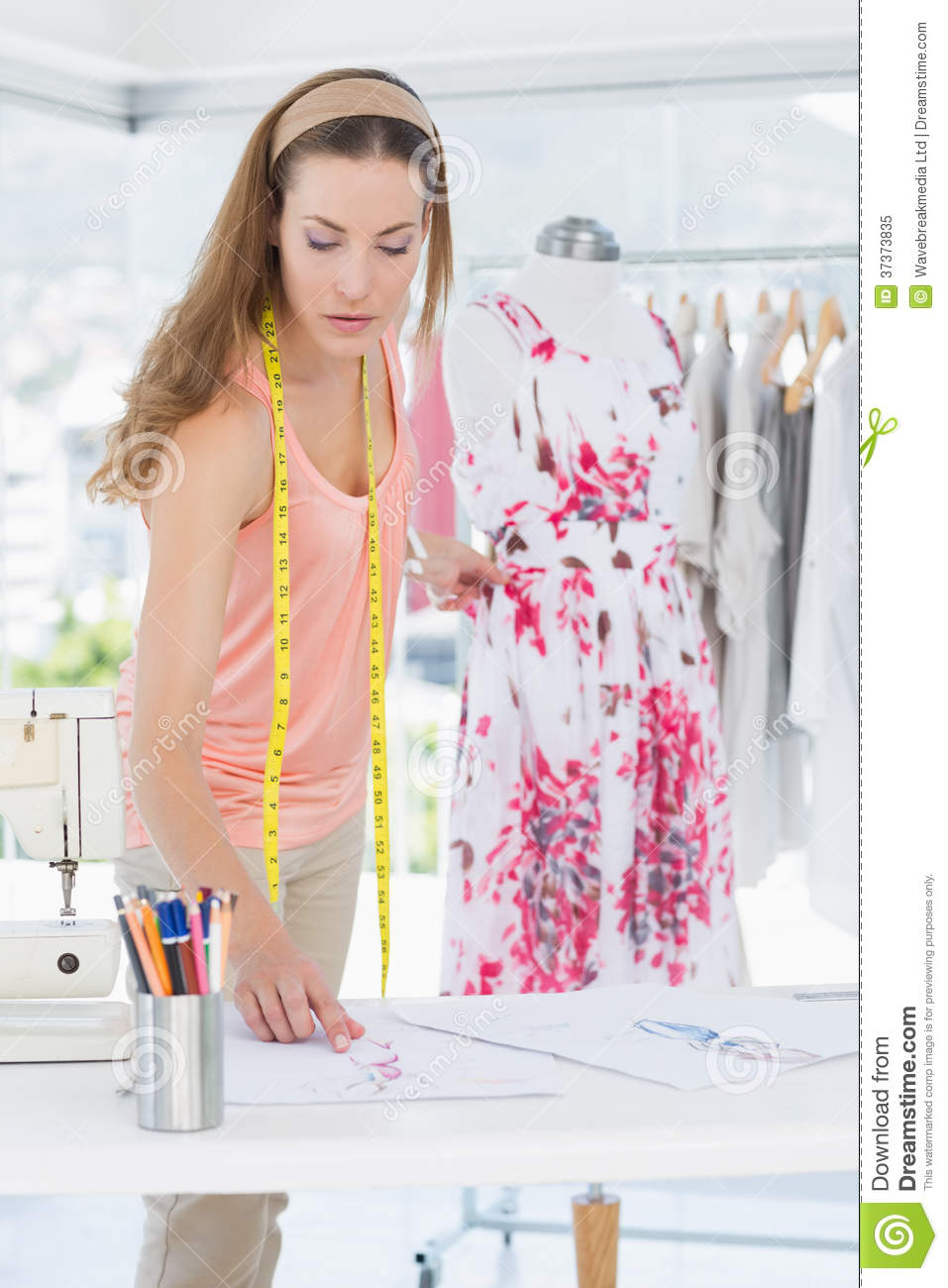 Female fashion designer working on floral dress royalty Contemporary fashion designers