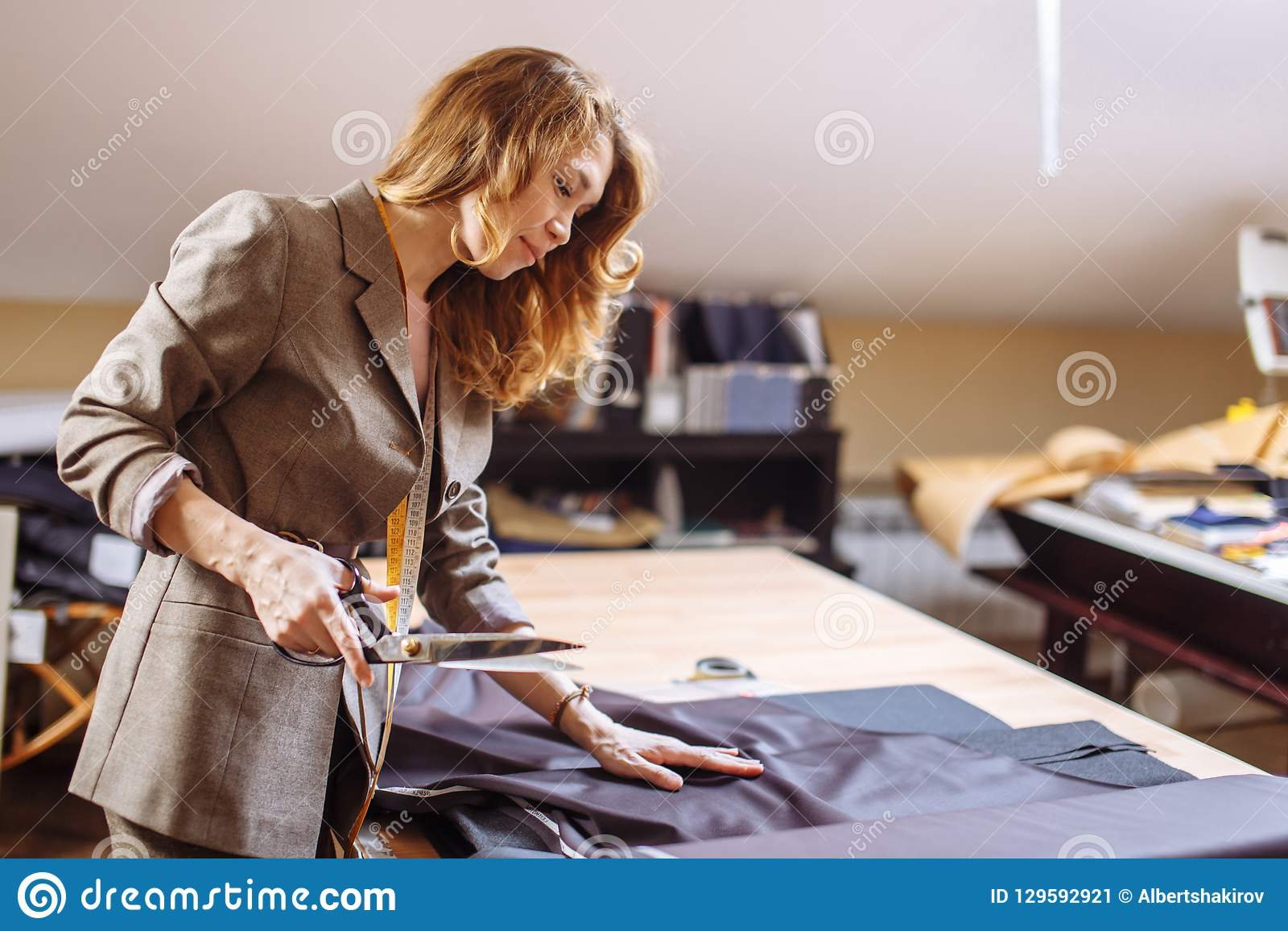 Female Fashion Designer Working On Suiting Fabric With Dressmaking Accessories On Table Stock Image Image Of Create Adult 129592921