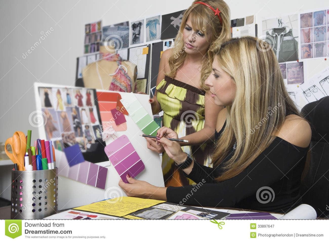 Female Fashion Designers Working At Desk Royalty Free