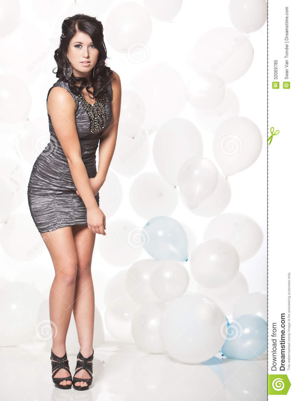 Female Fashion Model Posing With A Balloon Background