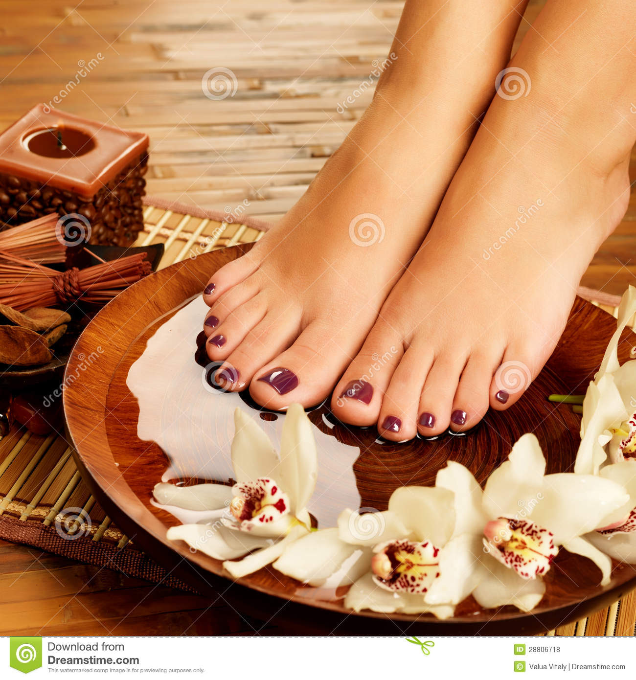 Female feet at spa salon on pedicure procedure stock photo for Photo salon