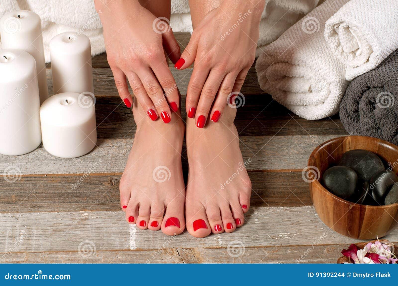 Female feet in spa salon, pedicure procedure