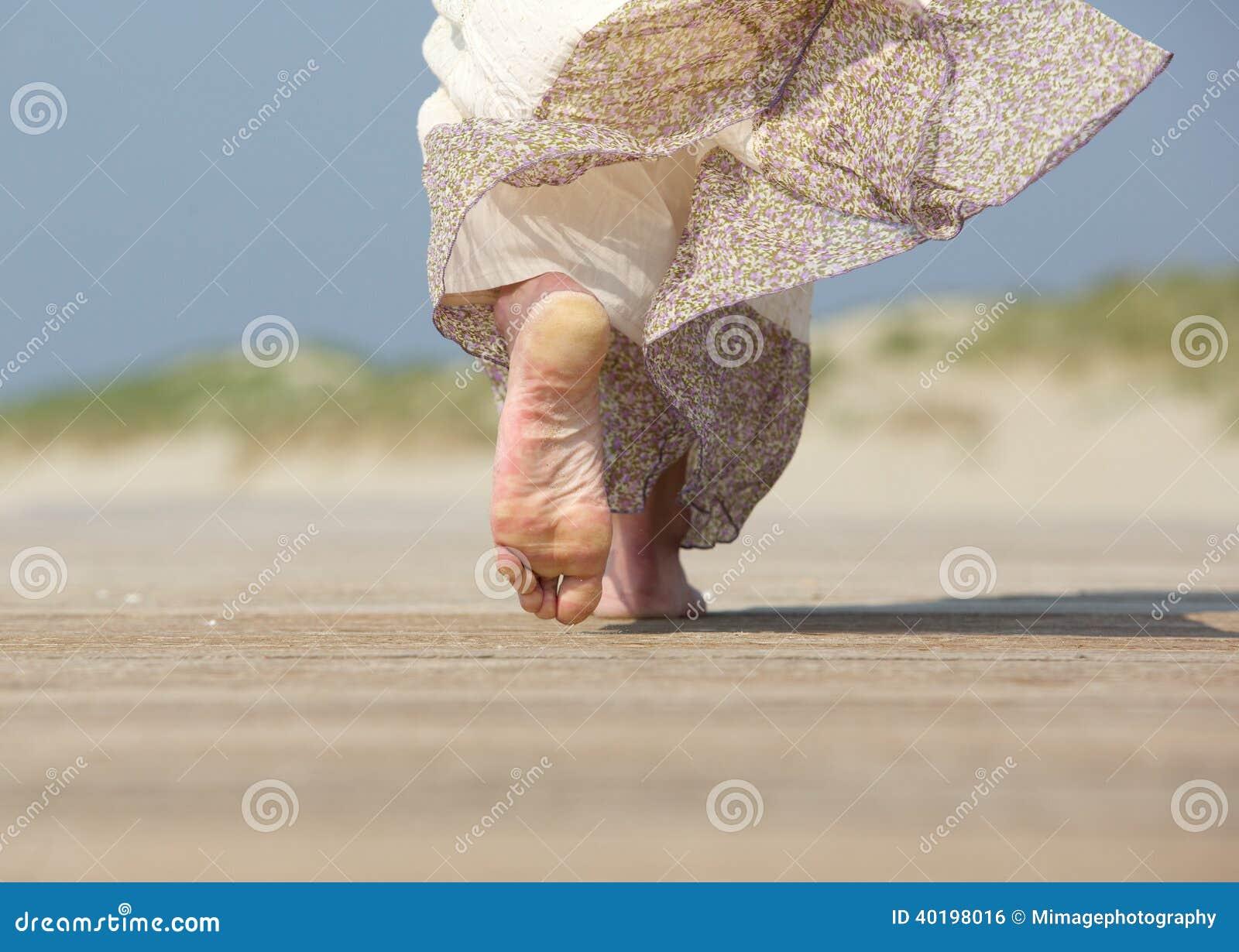 Female Feet Walking Away At The Beach Stock Photo Image