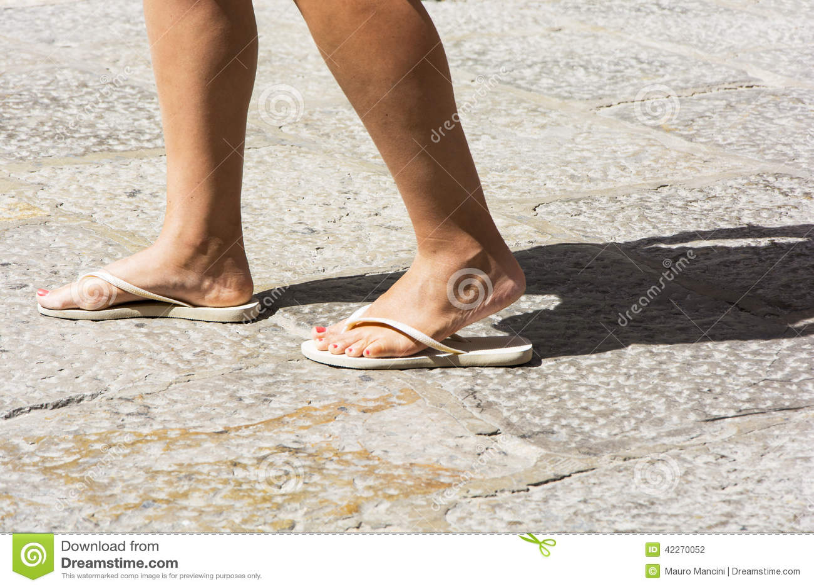 4a43736cf4c14 Female Feet Wearing White Flip-flops Stock Photo - Image of enjoying ...