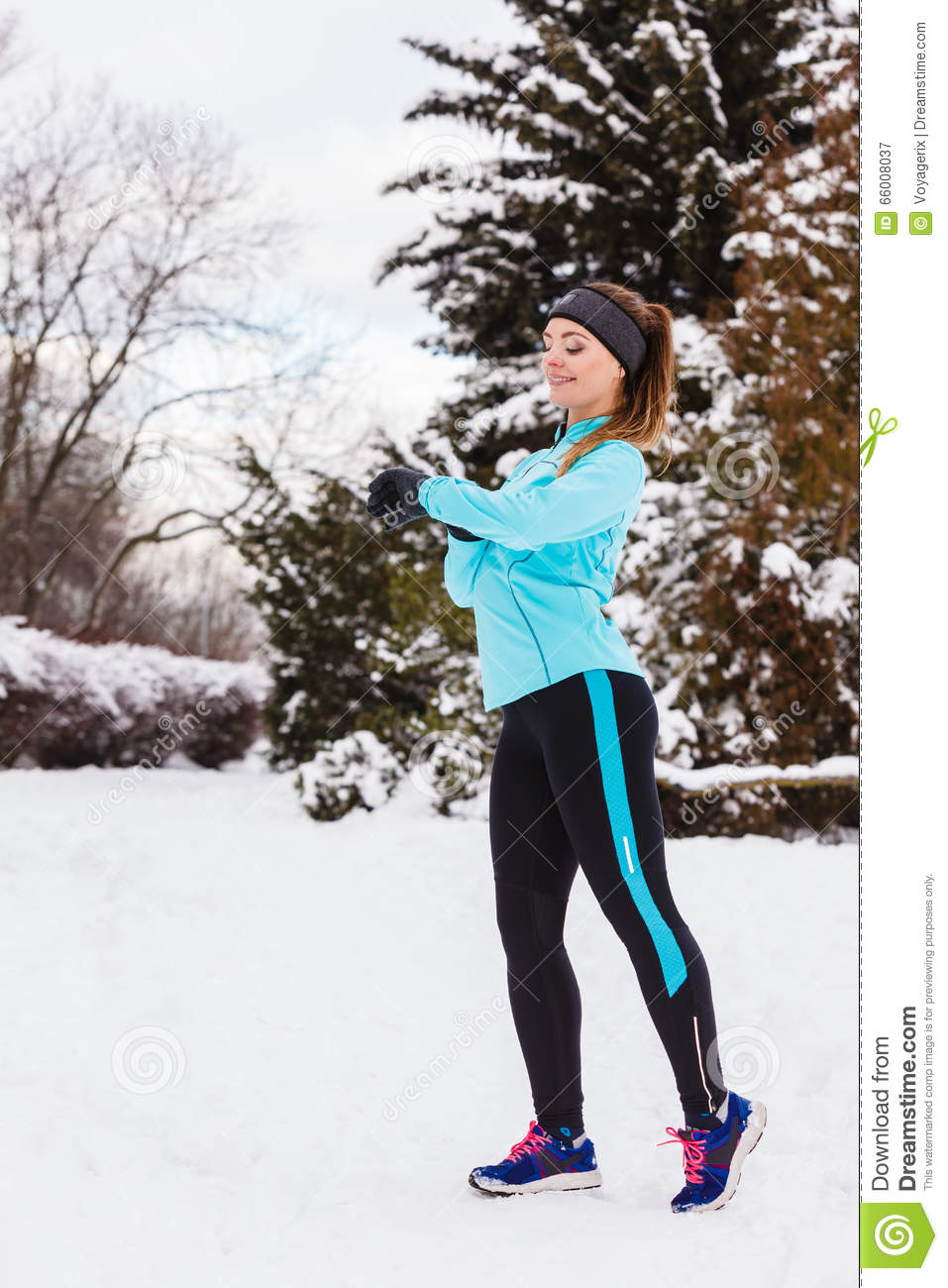 female fitness sport model outdoor in cold winter weather royalty