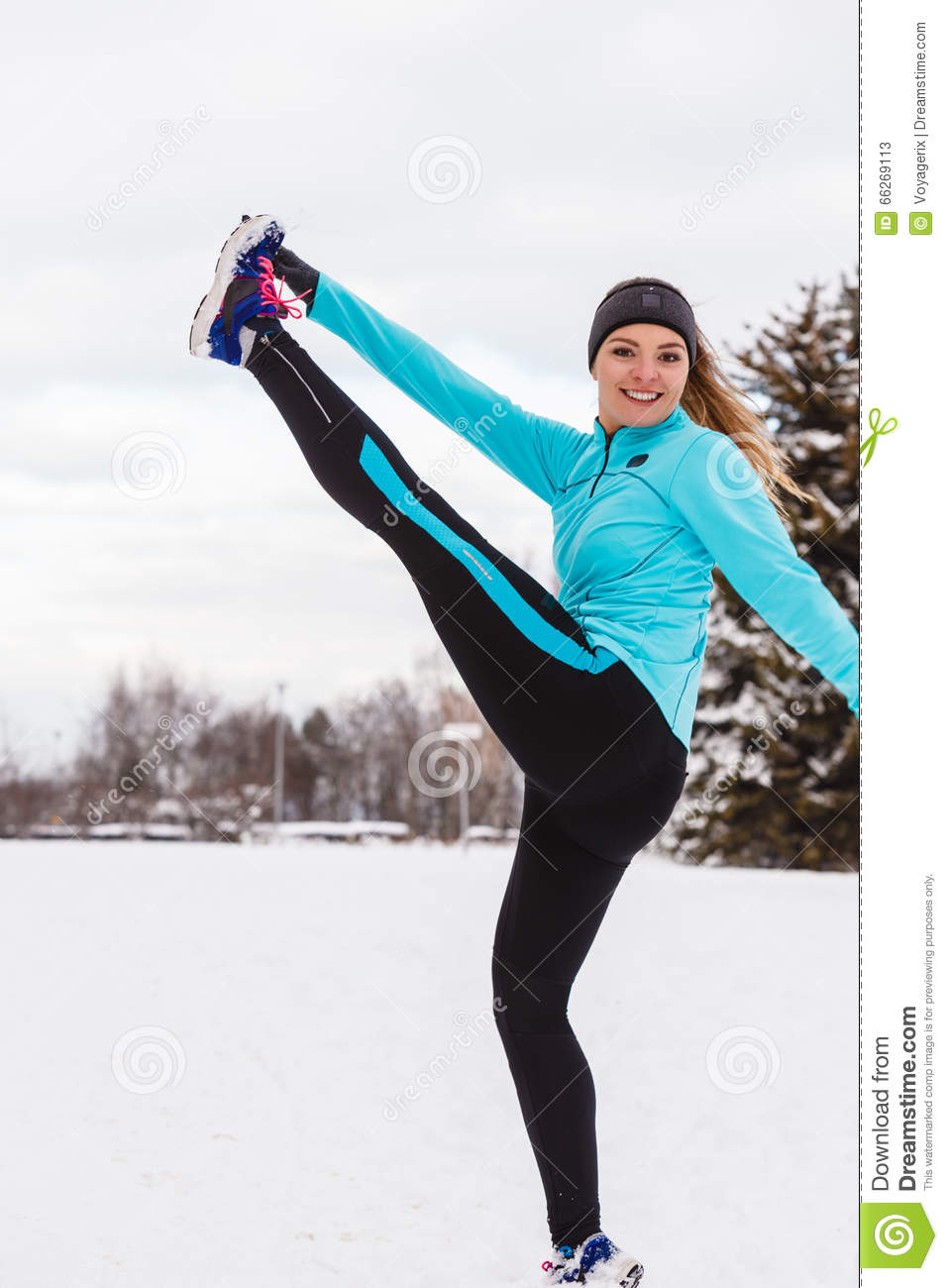 female fitness sport model outdoor in cold winter weather stock image