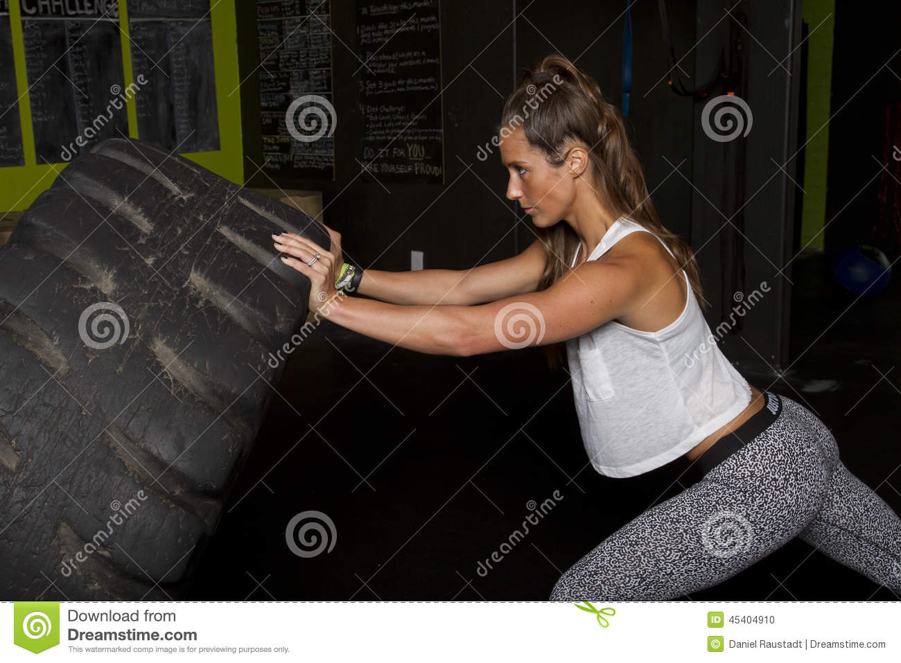Female Fitness Trainer with Heavy Tractor Tire