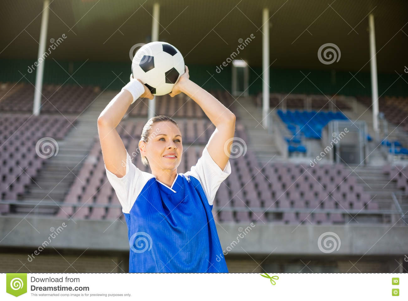 Female football player about to throw a football