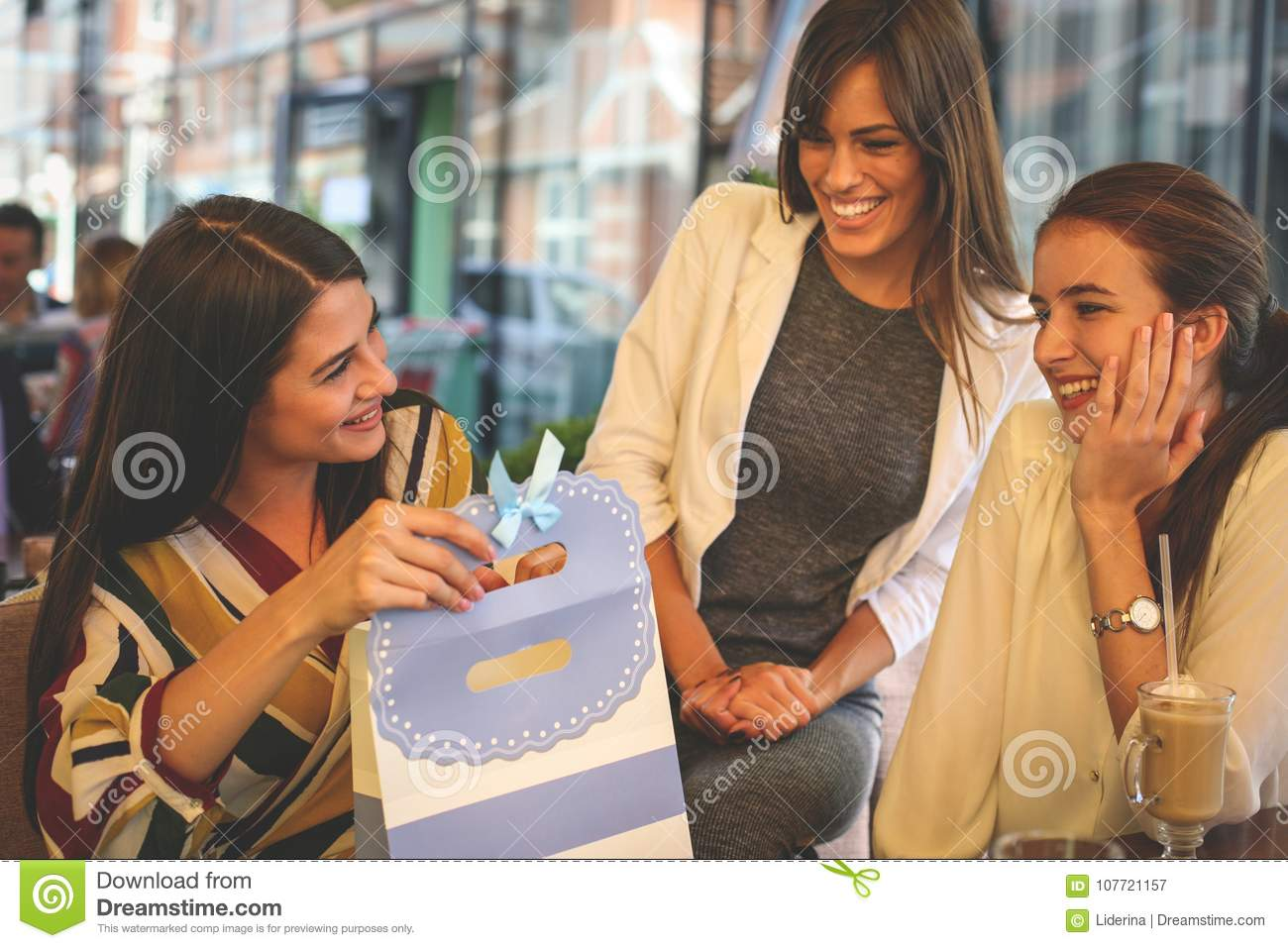 Female Friends Giving Birthday Gift