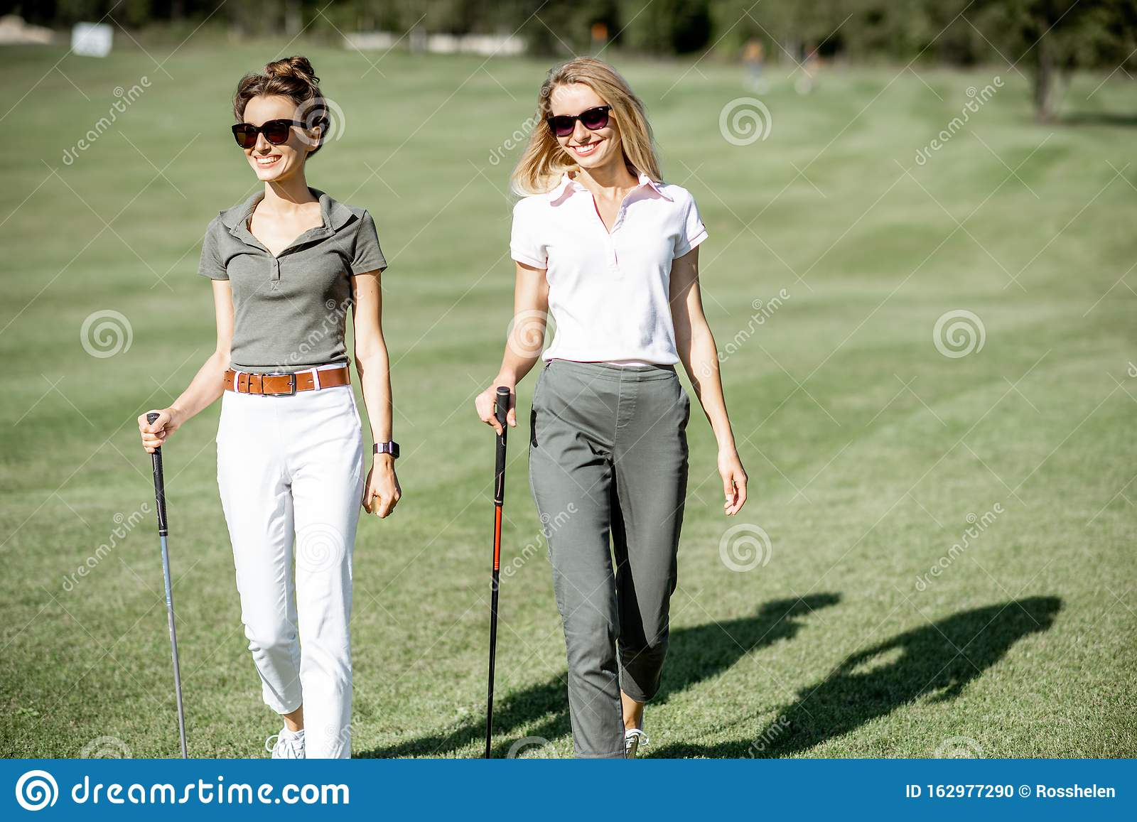 Female Friends On A Golf Course Stock Photo - Image of