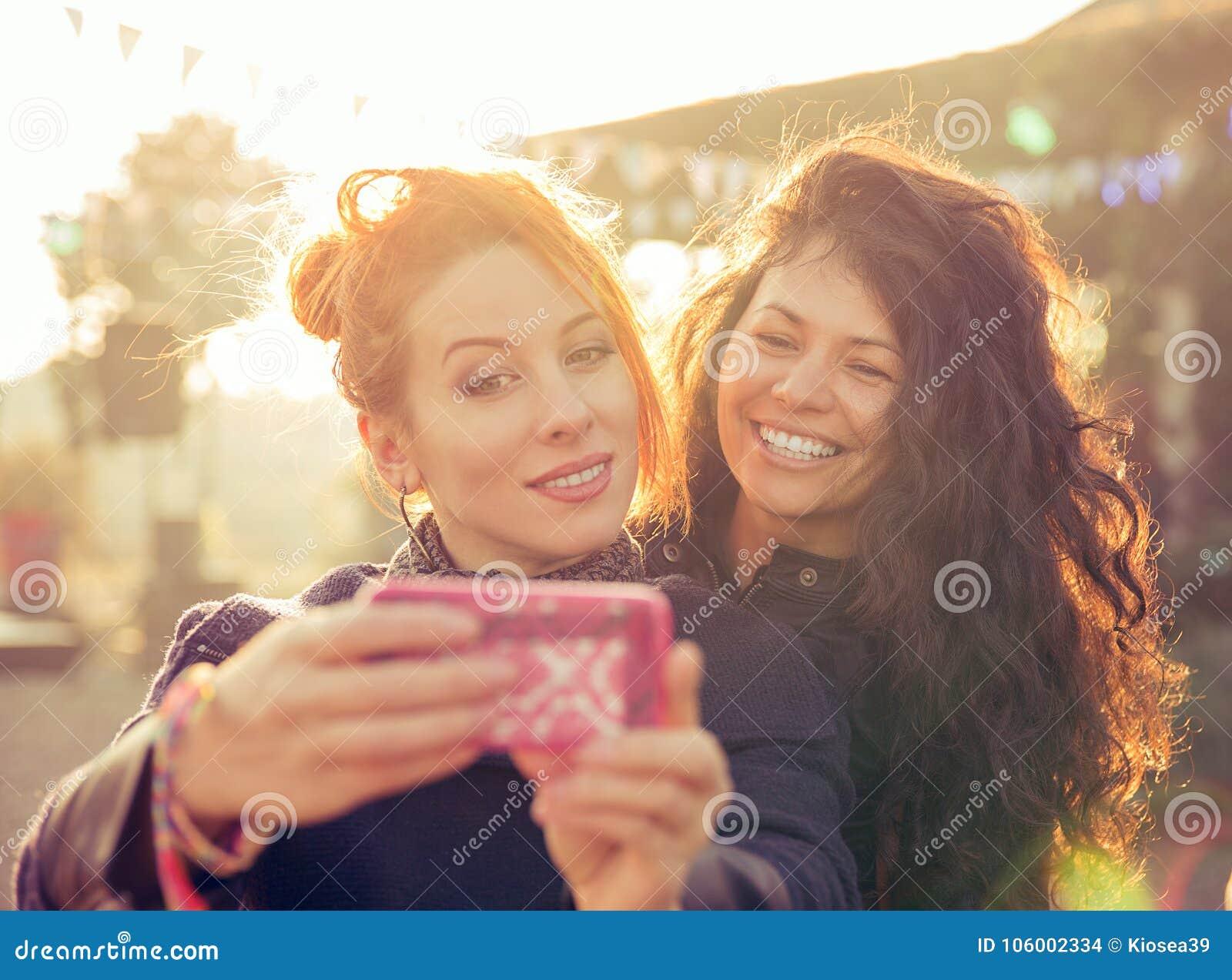Female friends two women taking selfie having fun during weekend getaway
