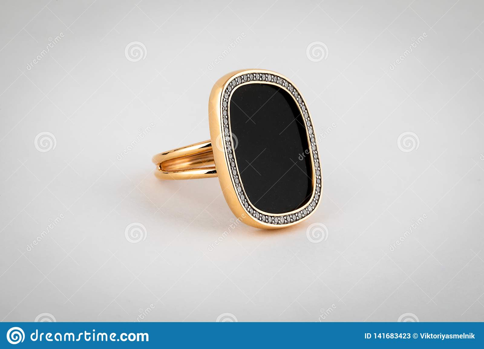 Female, Gold Ring With A Large Black Stone In The Middle, On