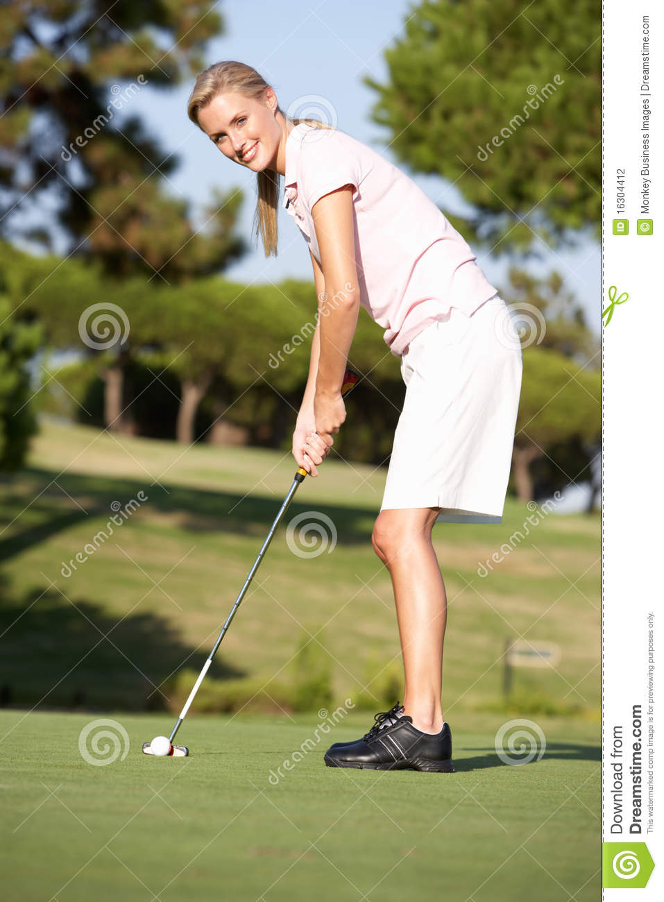 Young Female Golf Player On Course Stock Photo - Image of