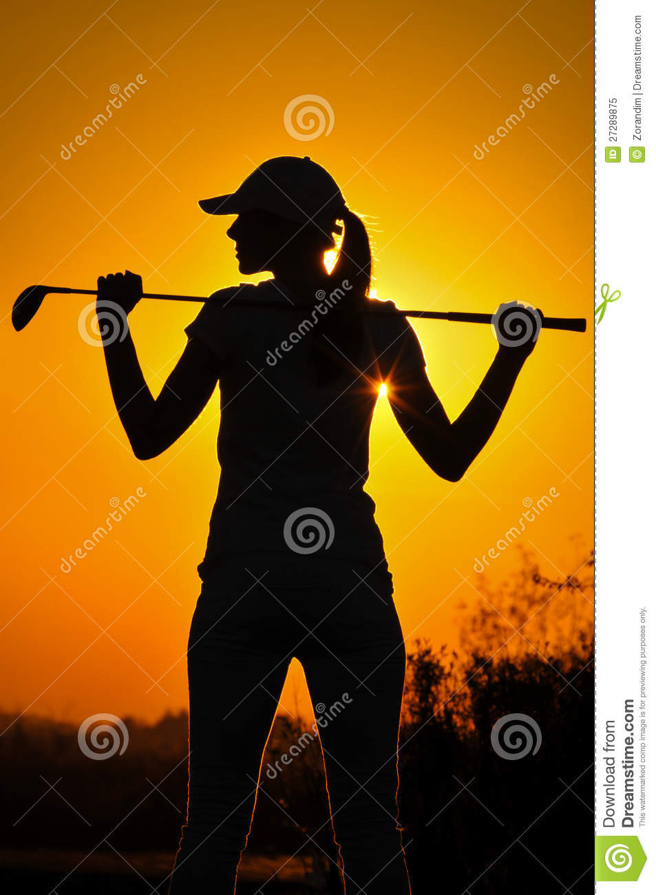Female Golfer Silhouette A woman is silhouetted against a brilliant ...