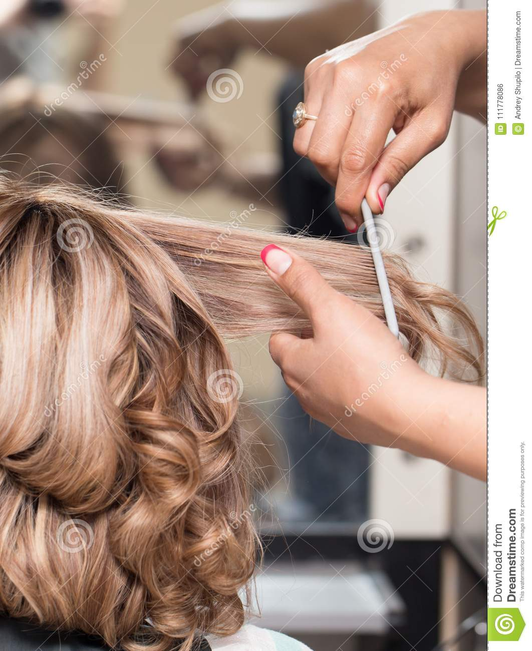 Female Hairstyles on curling in a beauty salon