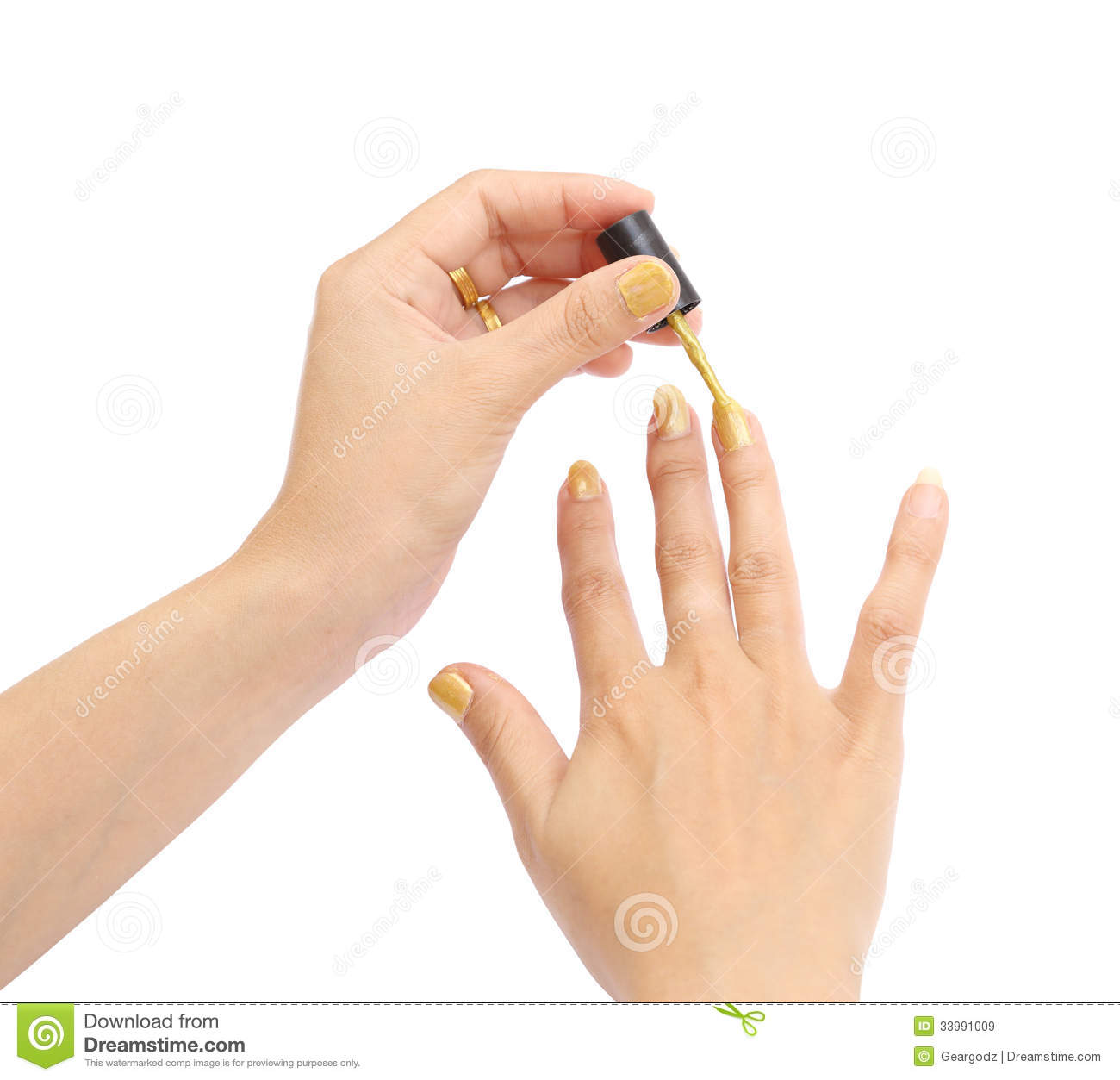 Nail Polish Colors For Younger Looking Hands: Female Hand With A Golden Nail Polish On White Background