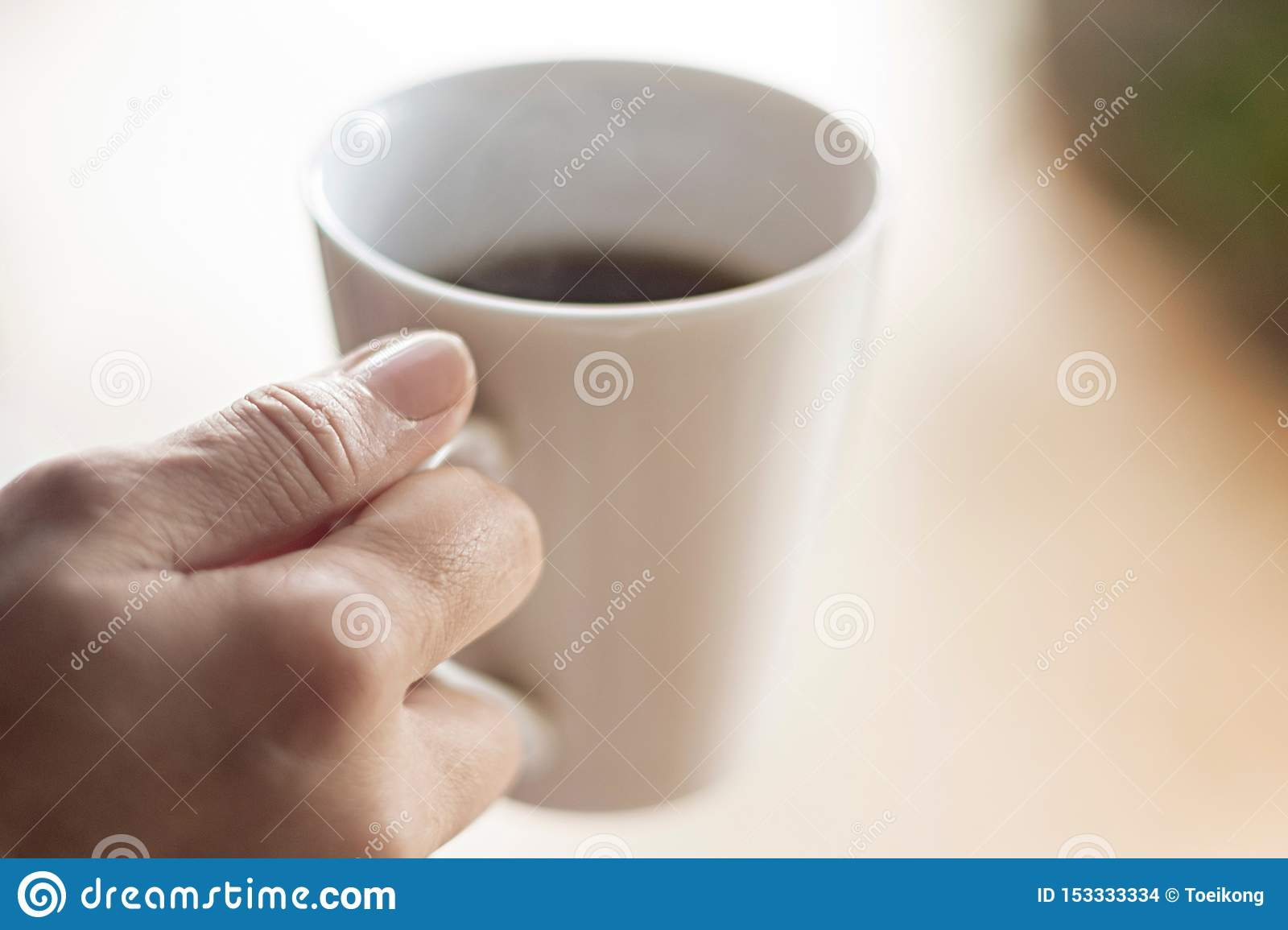 Female hand hold cup of coffee
