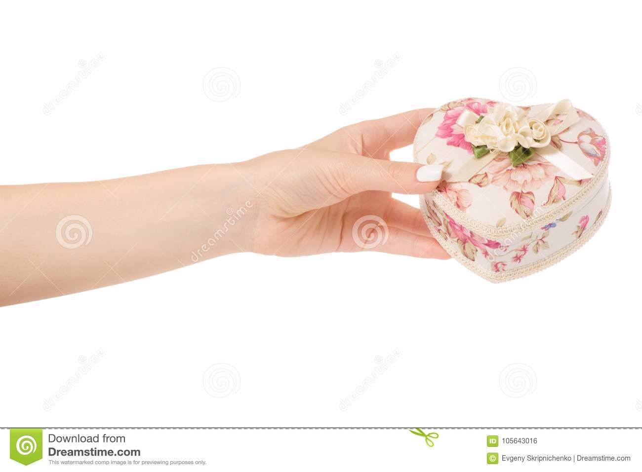 Female hand holding a casket jewelry