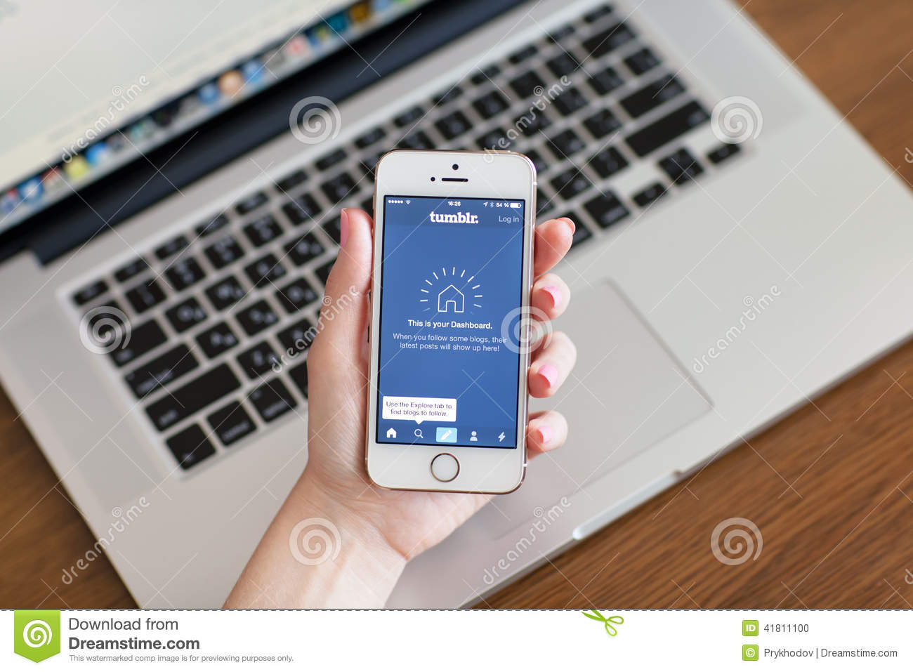 Female Hand Holding A White Iphone 5s With App Tumblr On The Screen On The Background Of Macbook Editorial Image Image Of Network Illustrative 41811100
