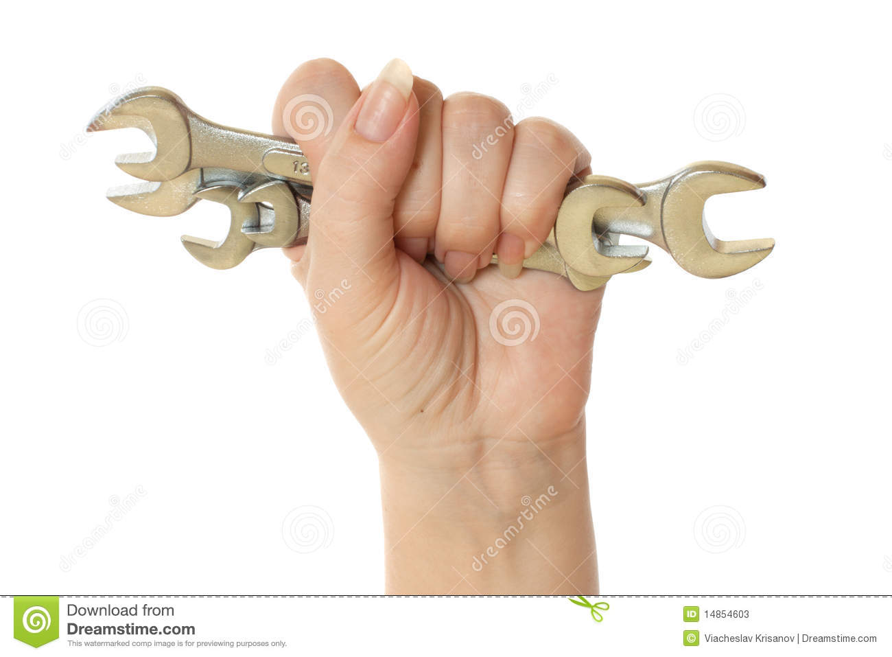 Female hand holding wrench tools