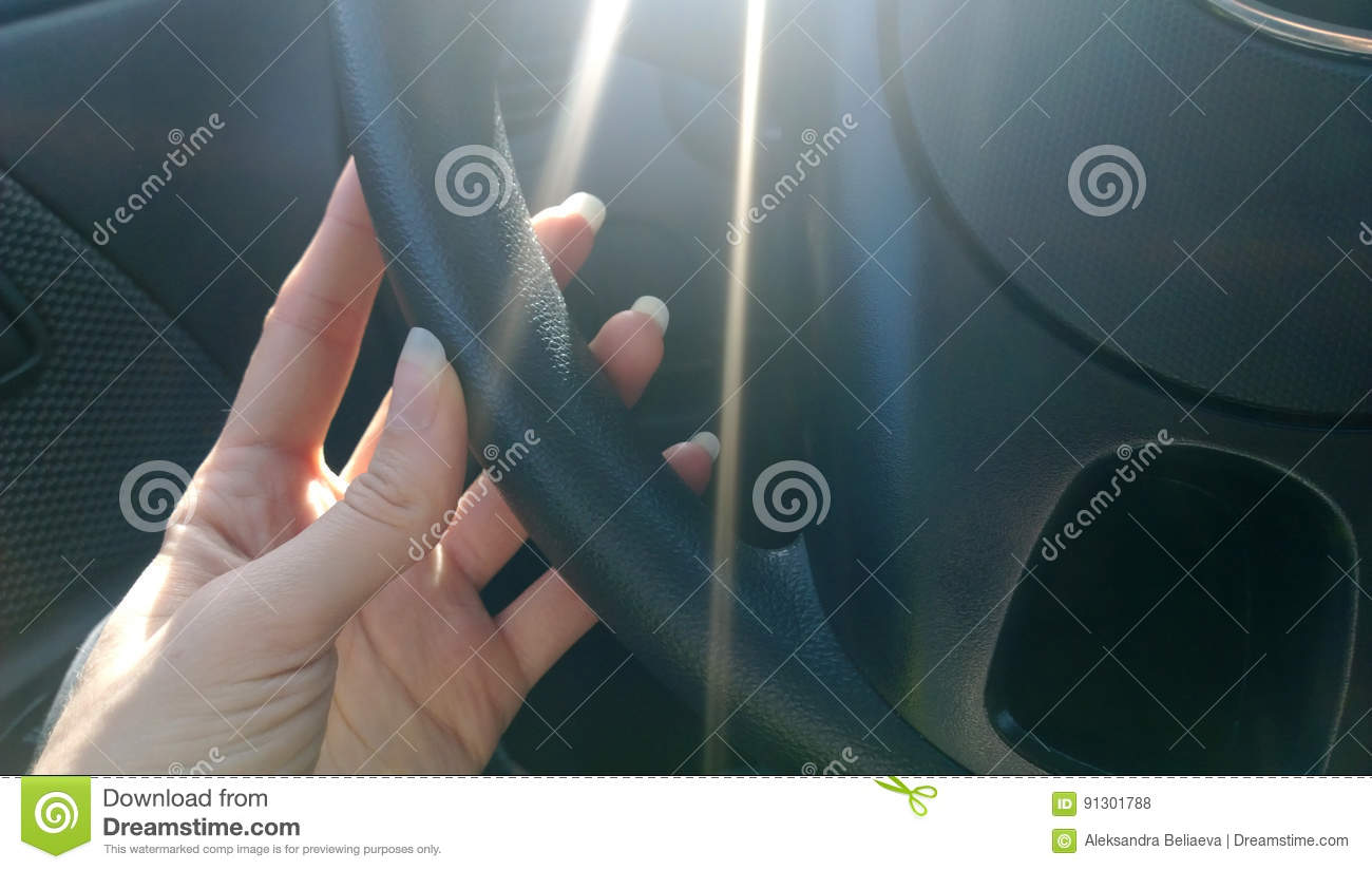 Female Hand With Long Natural Nails Incorrectly Holding The Wheel Of ...