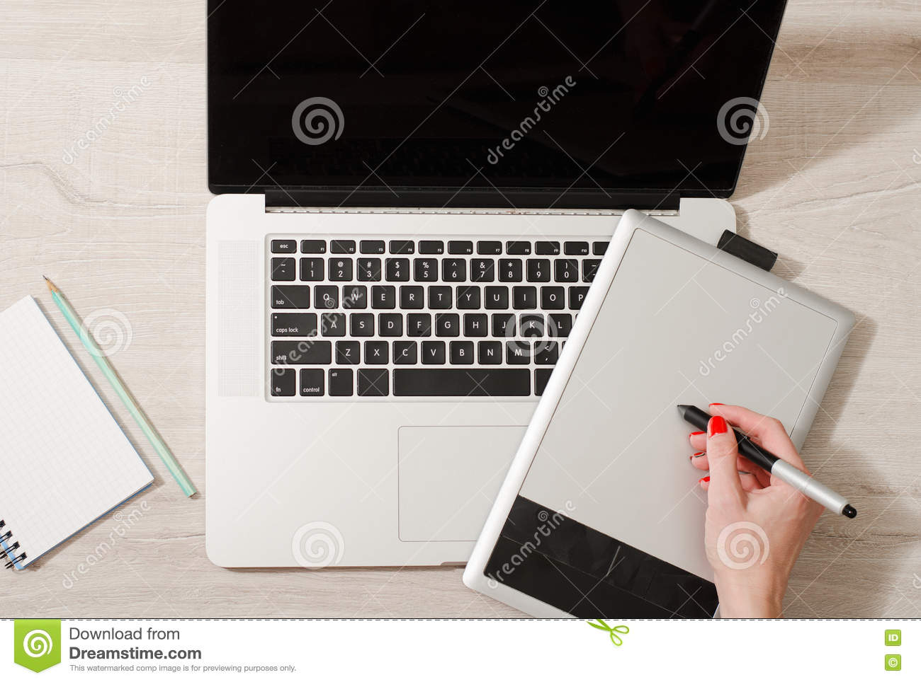 Female Hand With A Pencil Drawing On A Graphic Tablet Laptop