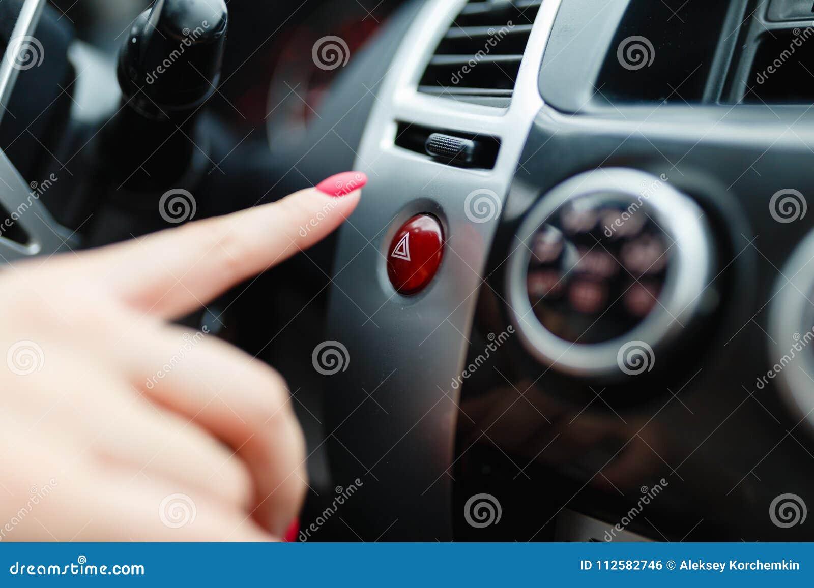 Female Hand Presses Button To Turn Alarm Car Emergency Lighting Shot Finger Woman Pressing Dashboard on Car Alarm Wiring Guide