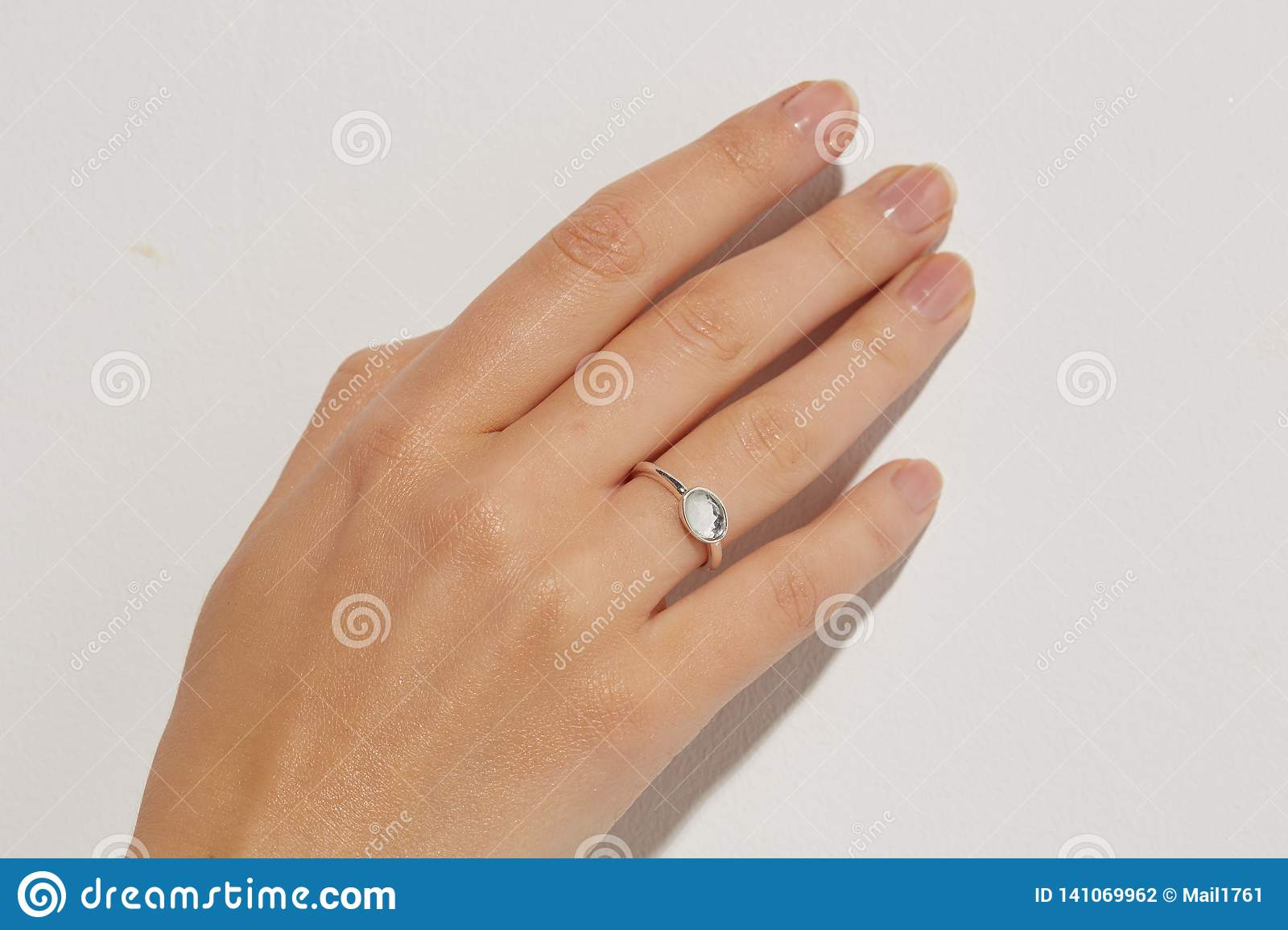 Female hand with a rings.