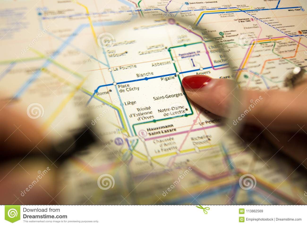 Paris Metro Map Download.Female Hand Showing Pigalle Metro Station On A Printed Paris Metro