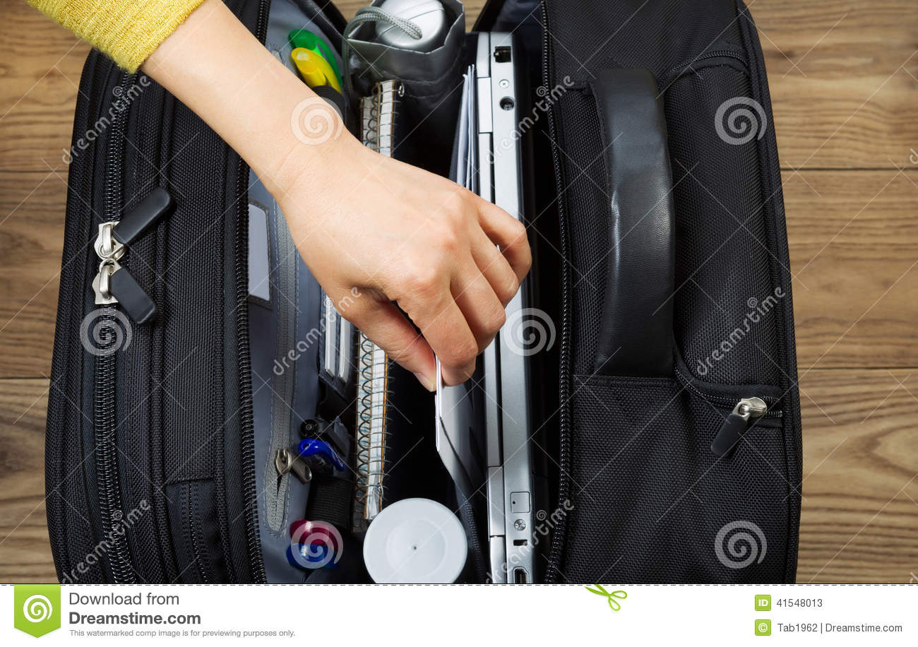 Female Hand Taking Out Office Supplies From Travel Bag Stock Photo ...