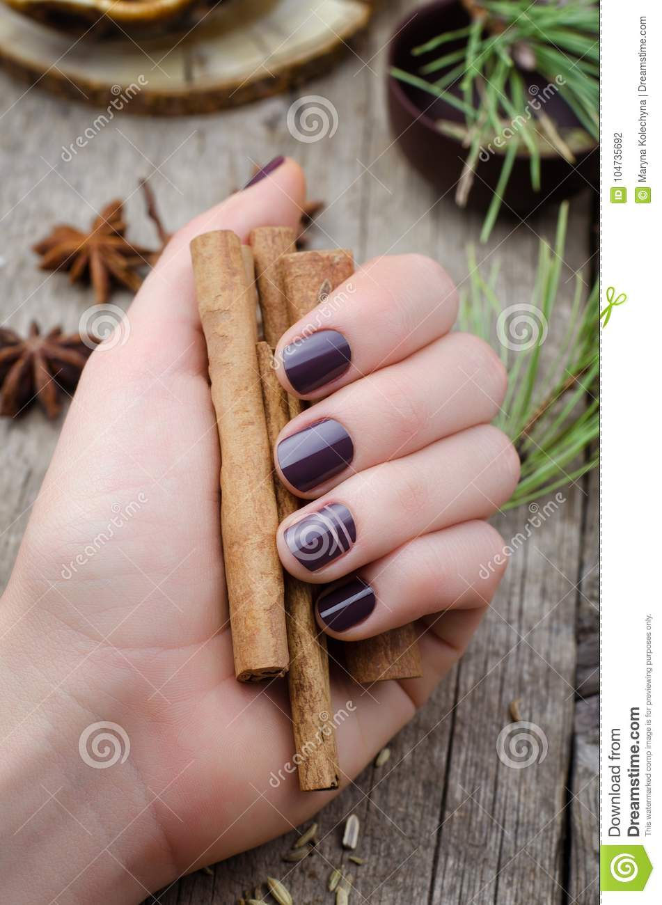 Female hands with dark purple nail design. - Female Hands With Dark Purple Nail Design. Stock Photo - Image Of