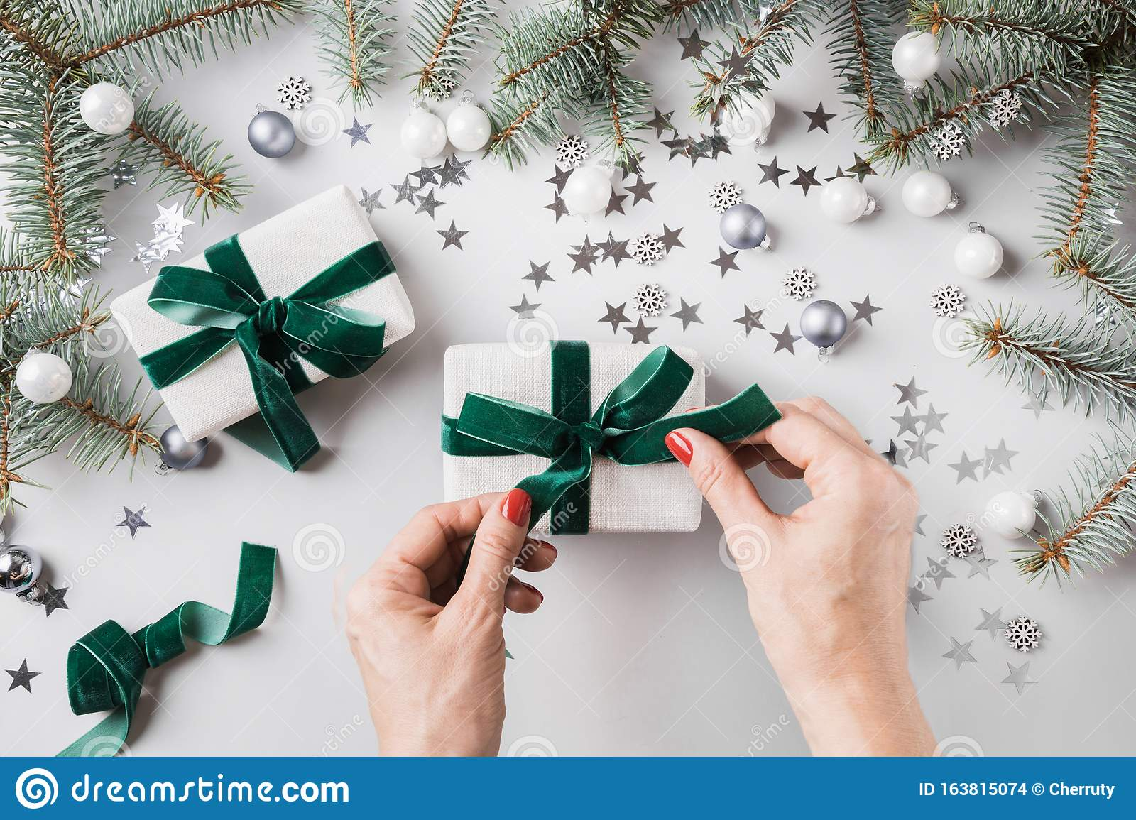 Female Hands Decorated Christmas Gift Box With Green Velvet Ribbon Stock Photo Image Of Ball Overhead 163815074