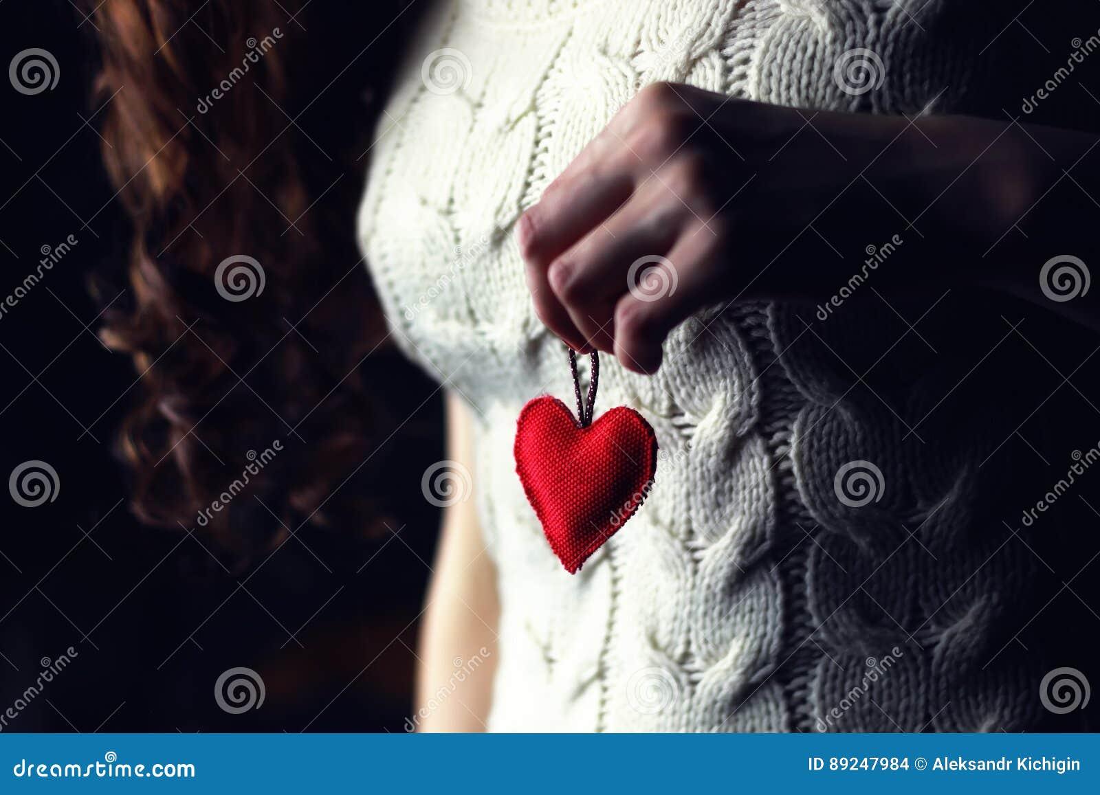 Female hands heart breast love