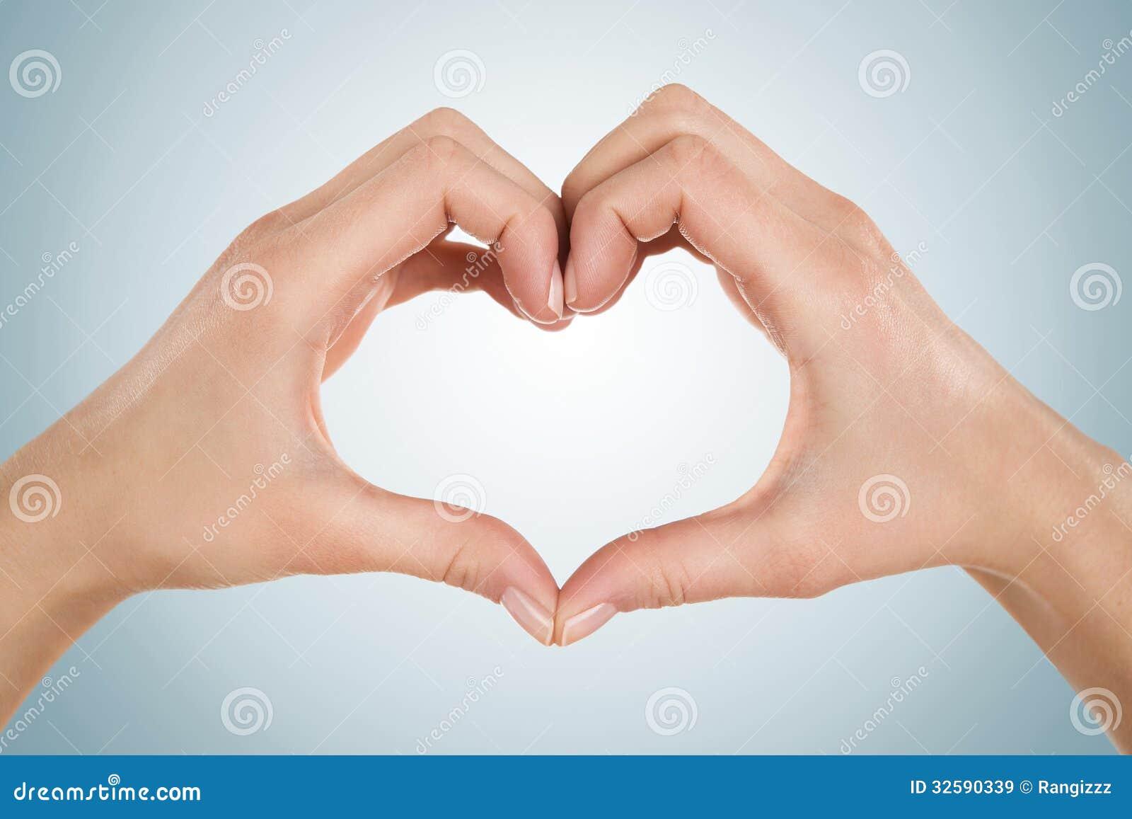 Female hands in heart shape