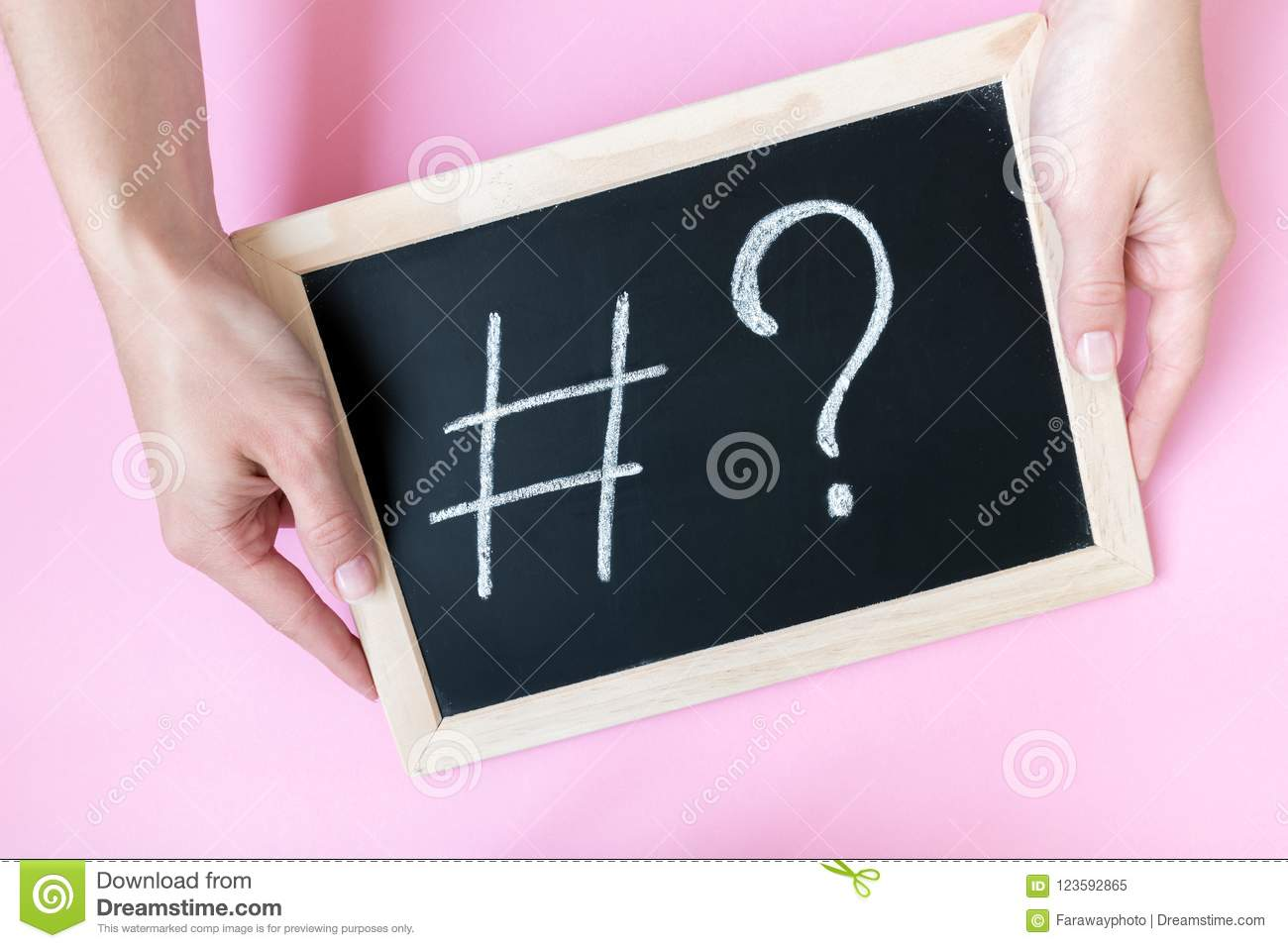 Hands holding chalkboard with hashtag sign