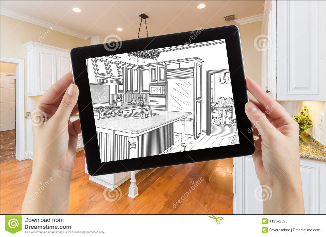 Female Hands Holding Computer Tablet with Drawing on Screen of Kitchen