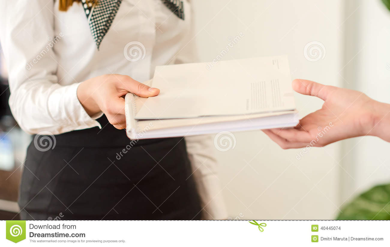 Female hands holding documents.